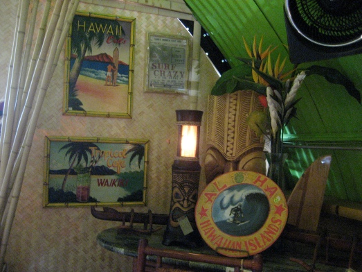 Retro Hawaii posters and tiki lamp