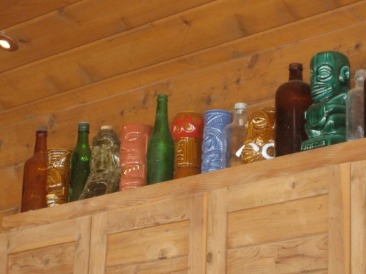 Vintage bottles and tiki mugs