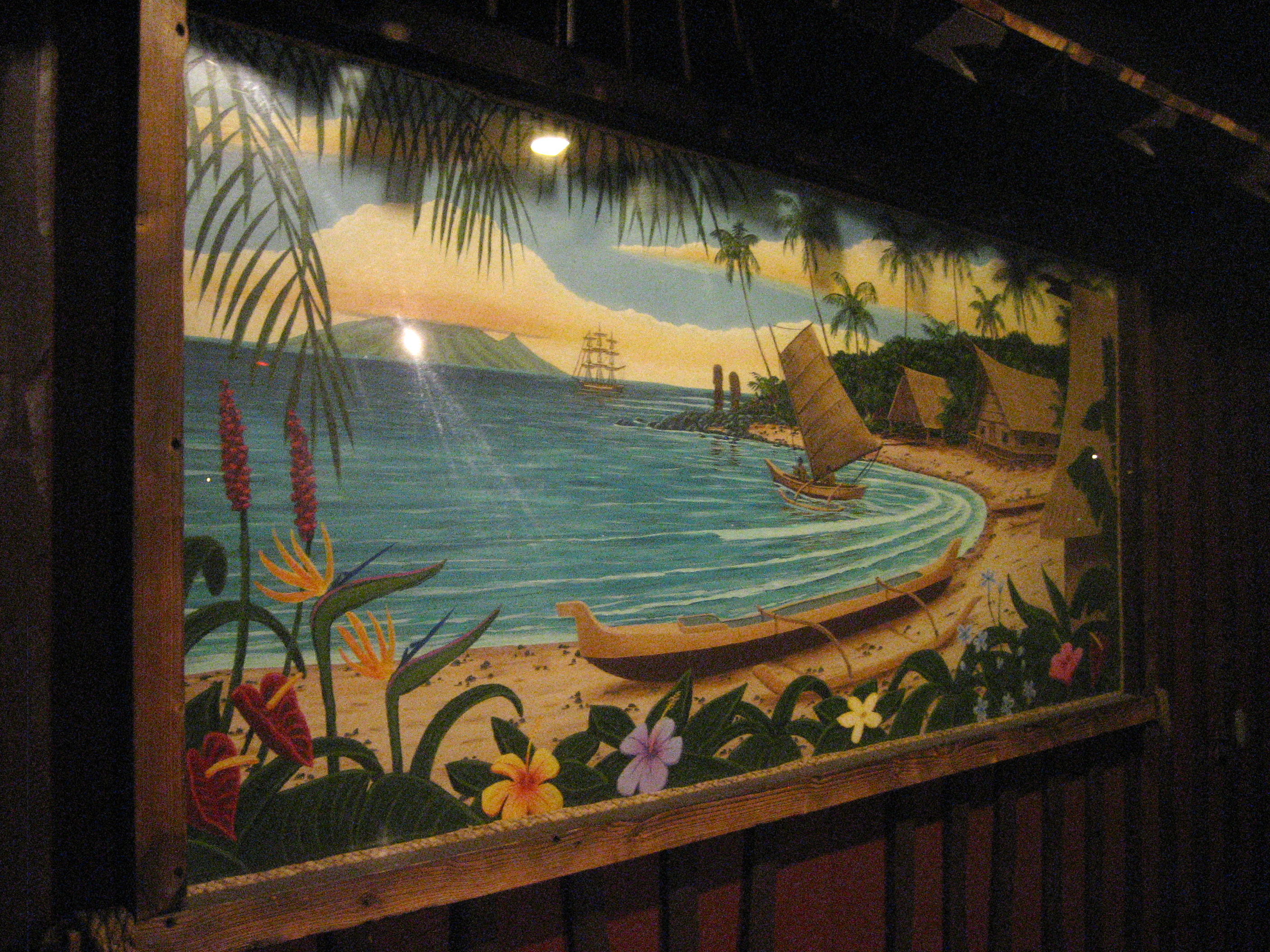 november 2010 the tiki chick there are four screens one in each corner and a snack bar projector building in the middle that s decorated with island themed murals tiki pillars